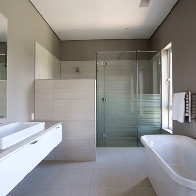 Custom-frameless-shower-with-sandbast-vinyl