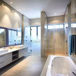 custom frameless showers and antique wall mirror